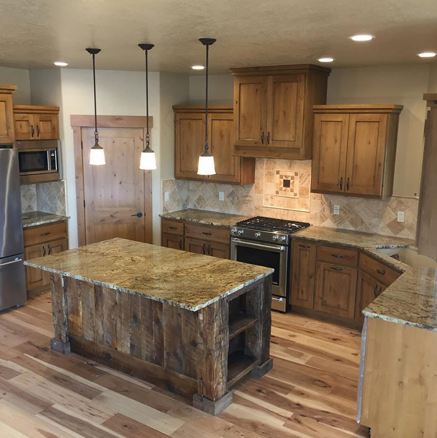 Kitchen With Golden Crystal Granite Countertops And Rustic